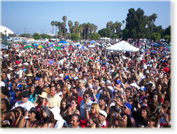 Displays the crowd at el Dia de San Juan Festival also known as the Puerto Rican Festival